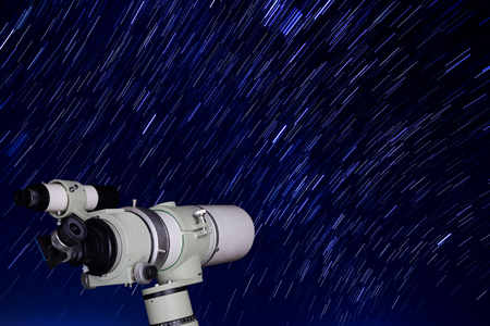 star trail: Telescope and beautiful star trail image during the night Stock Photo