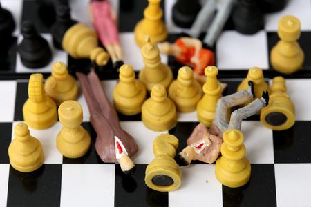 Businessman model on chess board.