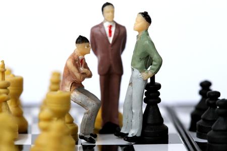 offense: Businessman model on chess board.