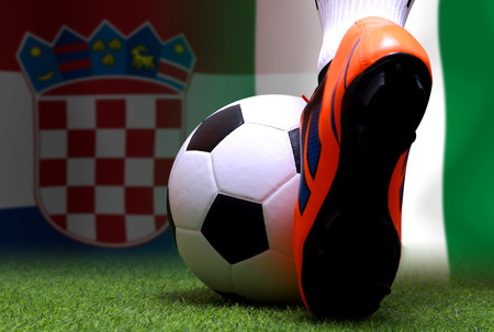 close up legs and feet of soccer player or football player walk on green grass ready to play football cup competition between the national Croatia and national Nigeria.