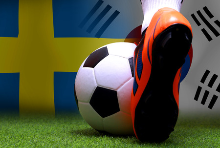 close up legs and feet of soccer player or football player walk on green grass ready to play match on national  South Korea and national Sweden. Standard-Bild - 103270056