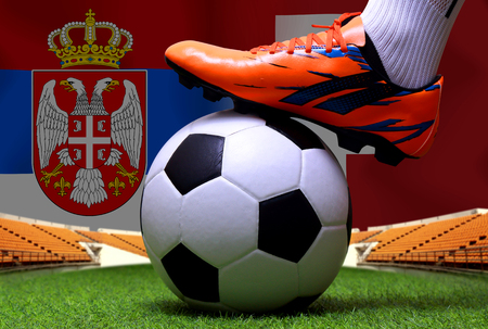 close up legs and feet of soccer player or football player walk on green grass ready to play match on national Serbia and national Switzerland. Standard-Bild - 103270059