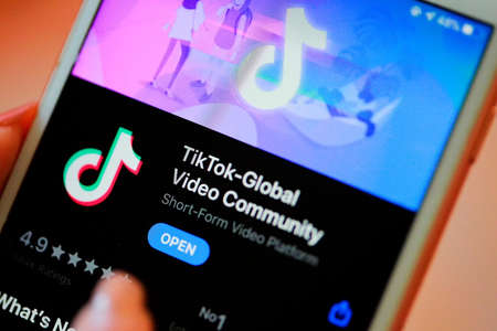 Nakhonratchasima, Thailand - May 31, 2020 : Tik Tok application information icon on Apple iPhone 8 close-up, which is a popular social media network is app to create and share videos on the internet.