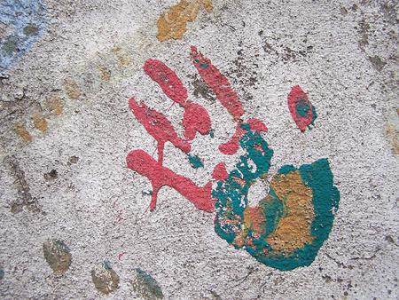 handprint: Multicolored handprint on wall