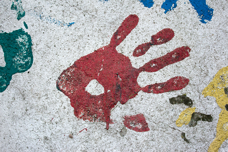 red wall: Red handprint on wall