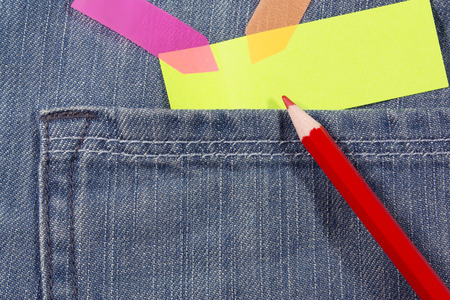 red pencil: red pencil and colorful blank note paper on jean pocket
