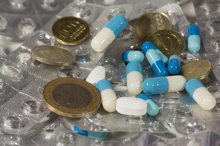 tl: medicine pills and coins