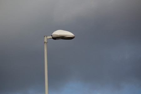 outdoor lighting: Outdoor public lighting pole with gray sky on background