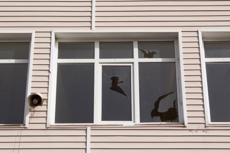 Broken Window and Horn Speaker Stock Photo