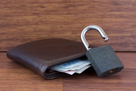 unlocked: Unlocked padlock,wallet and money Stock Photo