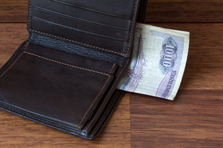 debt collection: old money in wallet