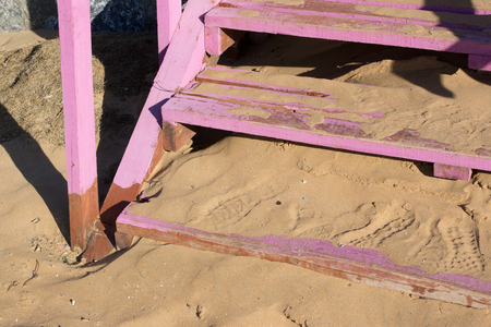 shoeprints on wooden steps