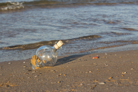 furlough: glass bottle on beach