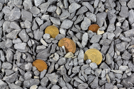 banking problems: old coins in pebbles