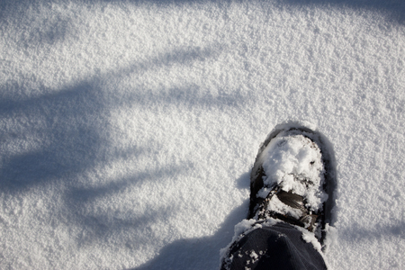 filming point of view: boot in snow