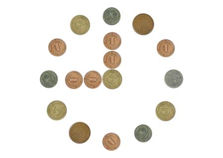 monete antiche: orologio con le vecchie monete