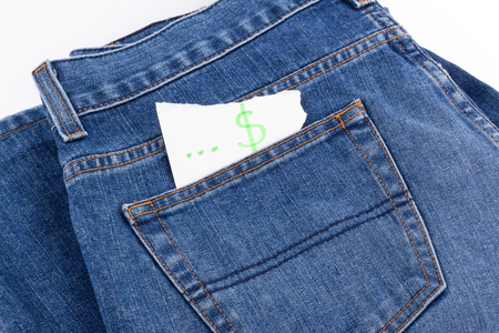 cheapness: dollar sign paper in jean pocket Stock Photo
