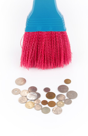 white interest rate: coins and broom Stock Photo