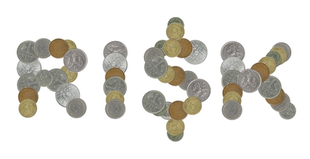 statistically: RISK word with old coins Stock Photo