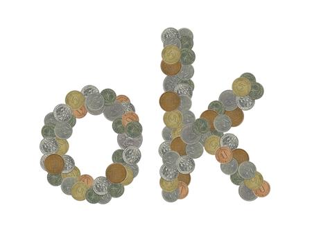 monedas antiguas: OK, la palabra bien con monedas antiguas Foto de archivo