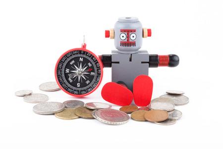 monete antiche: Robot con bussola e vecchie monete