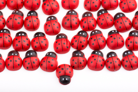 Opposition with wooden ladybug Stock Photo