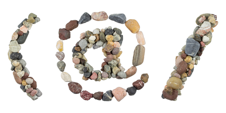 parentheses: At sign, parentheses and slash with sea stones Stock Photo