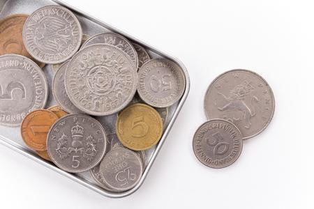 tin: Coins in tin box Stock Photo