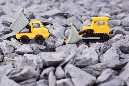 dumper truck: dumper truck and bulldozer on pebbles