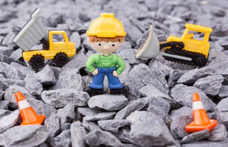 dumper: worker,dumper truck and bulldozer on pebbles