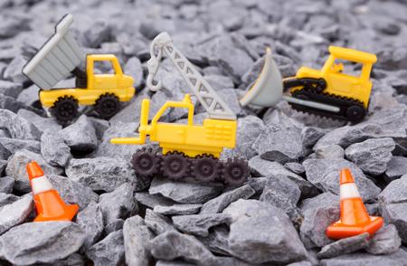 dumper truck: crane,dumper truck and bulldozer on pebbles