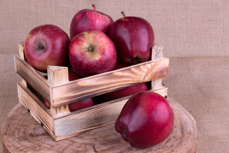 log basket: Red Apples in a Wooden Crate Stock Photo