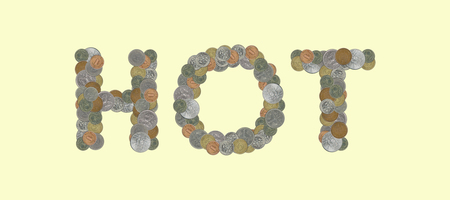 HOT - Coins on yellow background Stock Photo