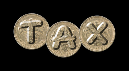 TAX - Coins on black background