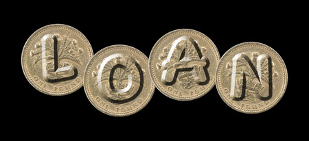 LOAN - Coins on black background Stock Photo
