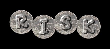 RISK - Coins on black background