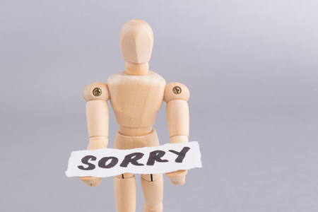 SORRY word with standing mannequin