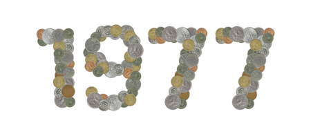 1977 - Old coins on white background Stock Photo
