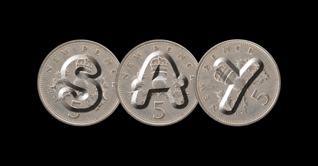 SAY written with old coins on black background
