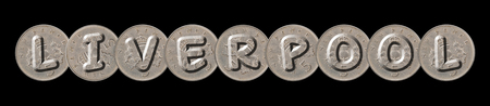 LIVERPOOL written with old coins on black background Imagens
