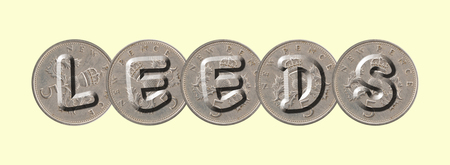 LEEDS written with old coins on yellow background