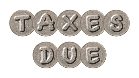 TAXES DUE written with old British coins on white background Imagens