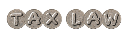 TAX LAW  written with old British coins on white background