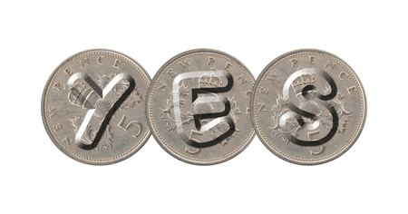 YES written with old British coins on white background