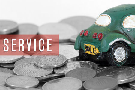 SERVICE word with car and old coins