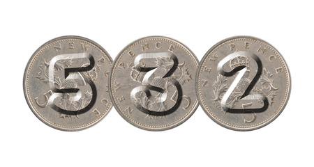 532 written with old British coins on white background Stock Photo