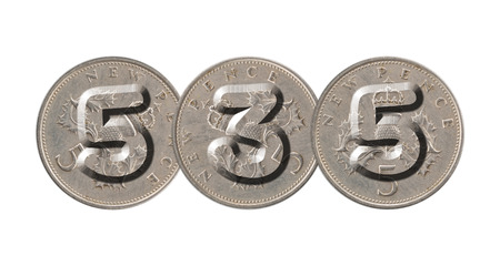 535 written with old British coins on white background Stock Photo