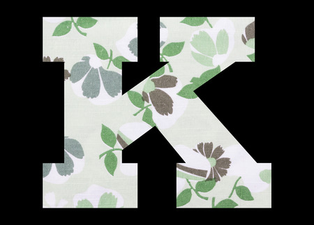 Letter K – with flowery fabric texture on black background