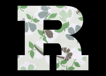 Letter R – with flowery fabric texture on black background