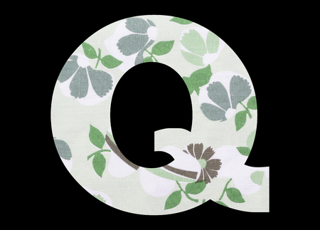 Letter Q – with flowery fabric texture on black background